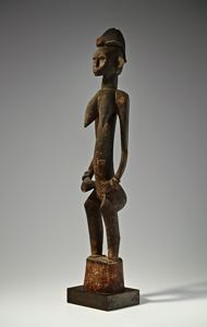 Image of Female rhythm pounder (deble or kulebele)